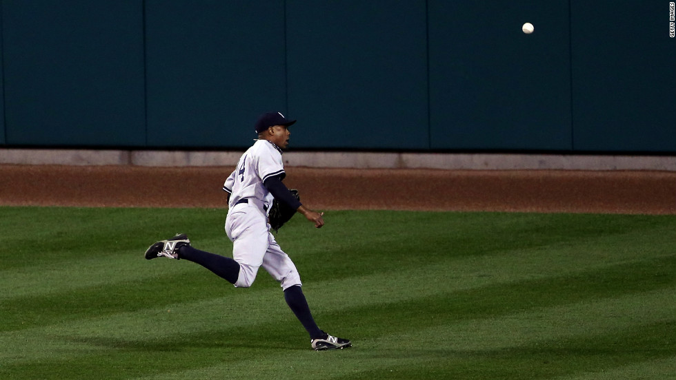Curtis Granderson of the New York Yankees fails to catch a fly ball hit by Miguel Cabrera of the Detroit Tigers in the bottom of the fifth inning.