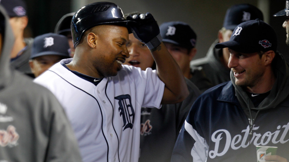 Delmon Young of the Detroit Tigers celebrates with teammates in the dugout after his home run.