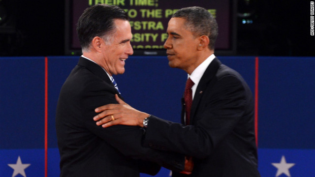 Republican presidential candidate Mitt Romney and US President Barack Obama shake hands following the second presidential debate at Hofstra University in Hempstead, New York, on Tuesday, October 16, moderated by CNN's Candy Crowley.