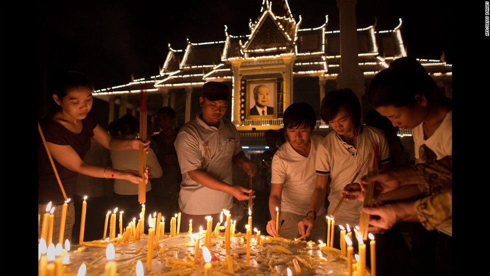 Cambodian people light candles on Tuesday evening.