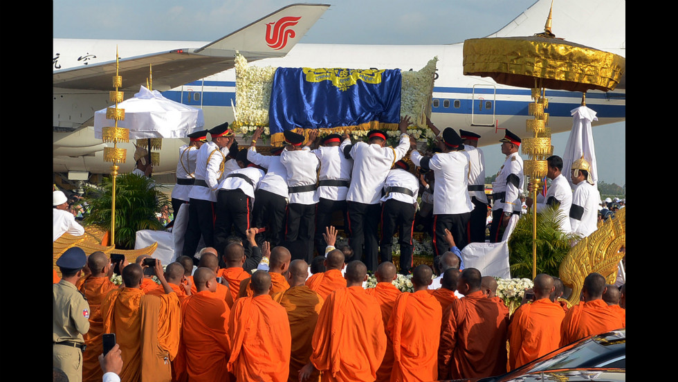 The coffin of former King Sihanouk is taken off the plane by a Cambodian honor guard, after it arrived at Phnom Penh International Airport on Wednesday.