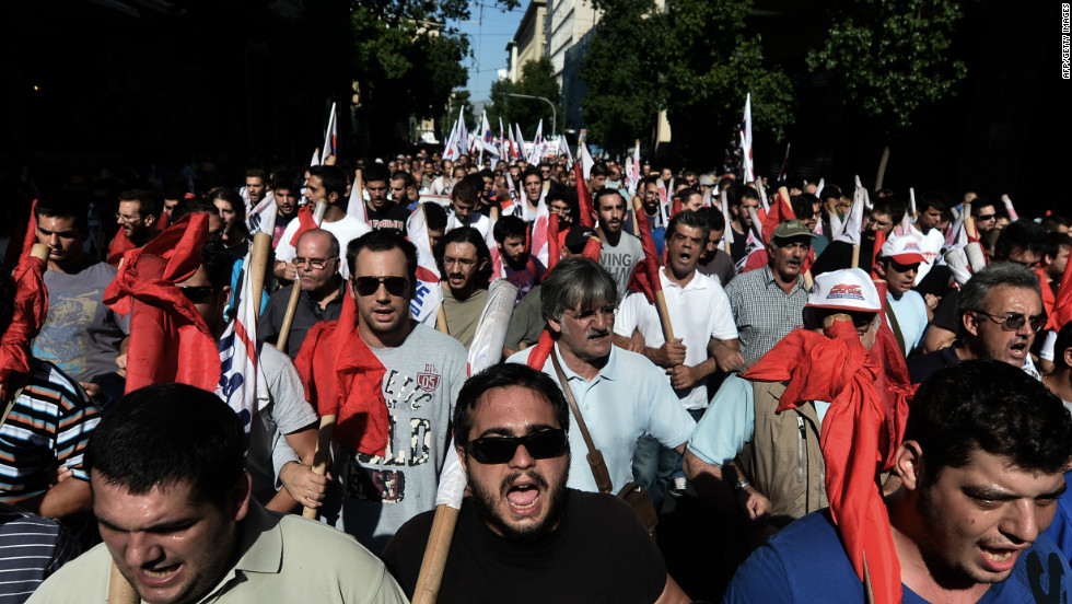 Demonstrators shout slogans during an anti-austerity rally in Athens.
