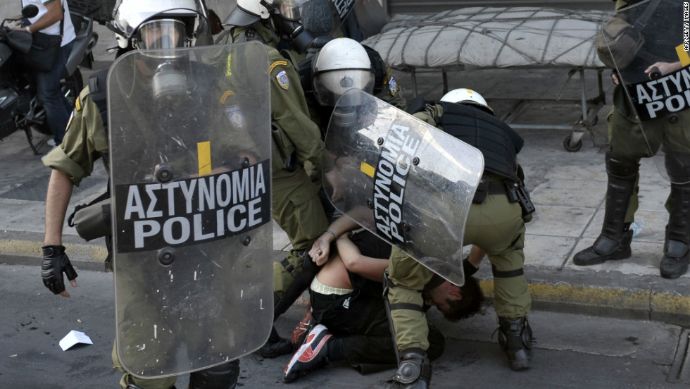 Police detain an anti-austerity demonstrator in Athens.