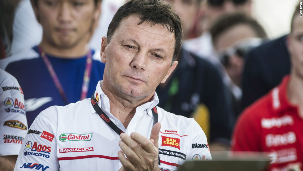 Fausto Gresini, team manager of San Carlo Honda Gresini, looks on struggling to hold back the tears. Simoncelli was the second rider Gresini has lost following the death of Japanese rider Daijiro Kato in a gruesome crash at Suzuka in 2003.
