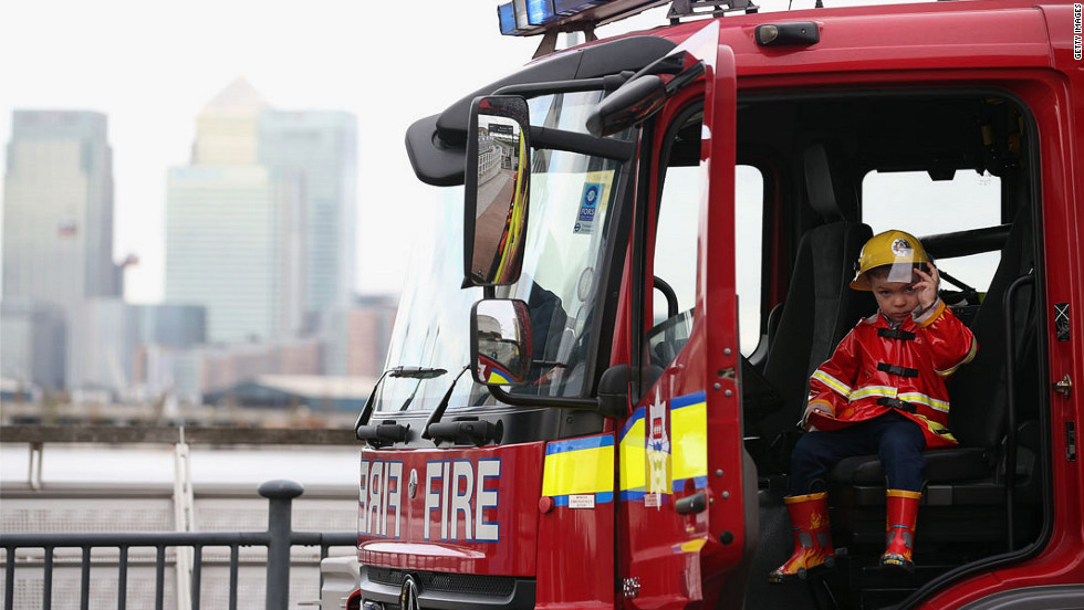 Three-year-old Liam Fuller sits in a fire engine at the Excel Center on Thursday.