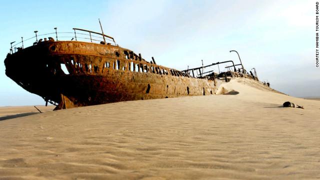 Ships' skeletons rest on the shore, beside whale bones.