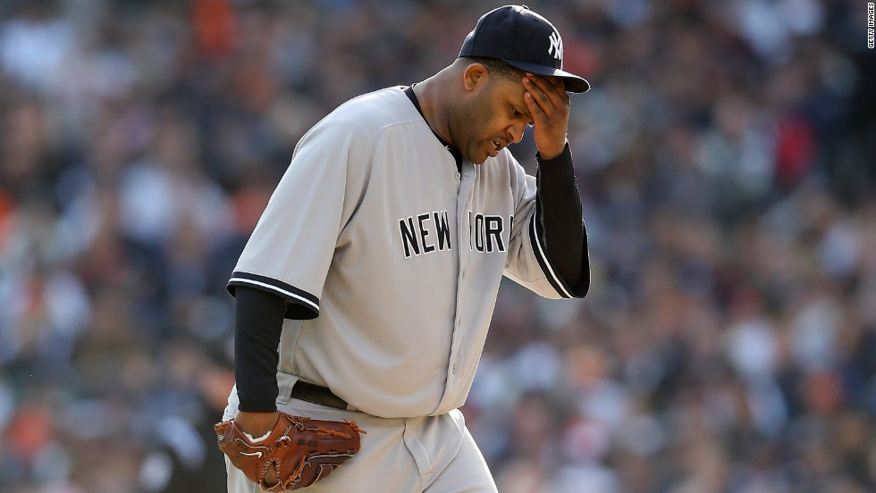 Pitcher CC Sabathia of the New York Yankees wipes his forehead during Game 4.