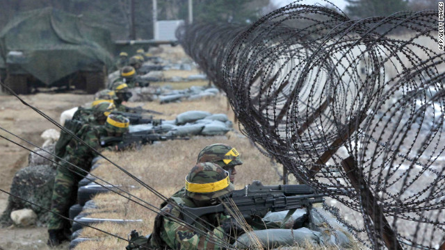 South Korean Marines take part in a a military exercise on Yeonpyeong Island on November 23, 2011.