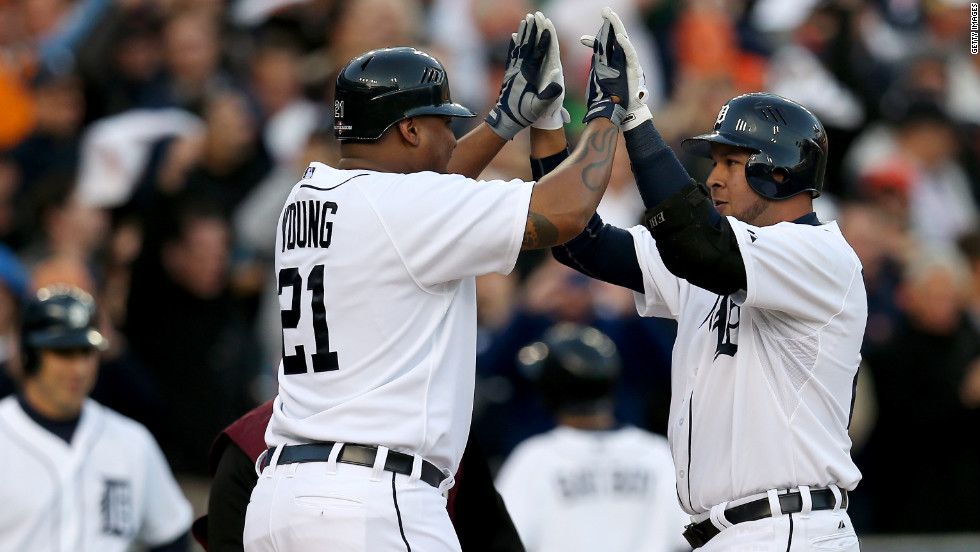 Delmon Young, left, and Jhonny Peralta of the Detroit Tigers celebrate after scoring on Peralta's two-run home run in the bottom of the fourth inning against the New York Yankees during Game 4 of the American League Championship Series at Comerica Park in Detroit on Thursday, October 18.
