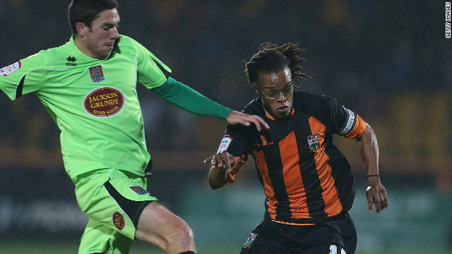 Edgar Davids made a return to action in Barnet's victory over Northampton in England's League Two.