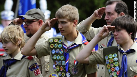 Members of the Boy Scouts salute during the raising of the flag on May 25, 2009 at the Willow River Cemetery in Hudson, Wisconsin during Memorial Day ceremonies.