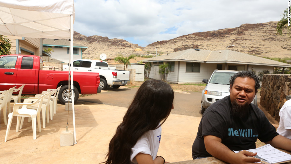 Volunteers from Kanu Hawaii go door to door convincing people to vote — for anyone.