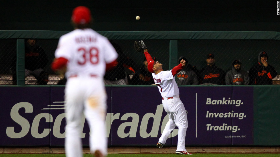 No. 7 Matt Holliday of the St. Louis Cardinals stretches to make a catch on a ball hit by No. 9 Brandon Belt of the Giants in the eighth inning.