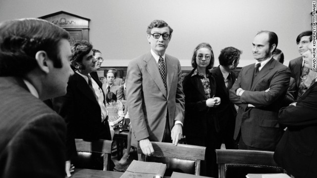 Hillary Rodham, center, a lawyer for the Rodino Committee, and John Doar, left, Chief Counsel for the committee, bring impeachment charges against President Richard Nixon in the Judiciary Committee hearing room at the U.S. Capitol in 1974 in Washington, DC.