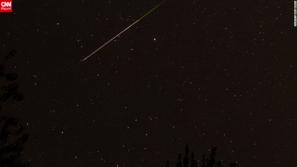 "Using a Canon 5D Mark II camera, <a href=""http://ireport.cnn.com/docs/DOC-861953"">Mike Black</a> photographed the Orionid meteor shower early Sunday morning. ""When one of those bits of rock enters our atmosphere, it burns up and we get to enjoy a meteor shower. It's just one of nature's spectactular shows,"" he said."