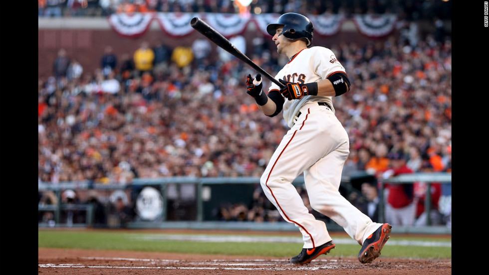 Marco Scutaro of the San Francisco Giants hits a two-run double.