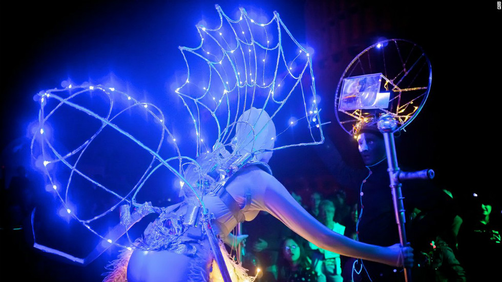 A dancer hooked up to motion sensors performs at the opening of the CSI in September 2012.