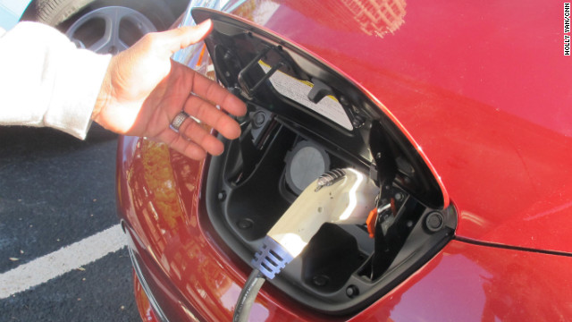 Charging an electric car is much like filling up with gas, as Randy Stanley demonstrates with his Nissan Leaf.