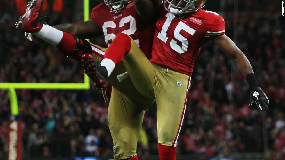 Michael Crabtree (15) and Chilo Rachal of the San Francisco 49ers celebrate a touchdown in their 2010 victory over the Denver Broncos at Wembley.