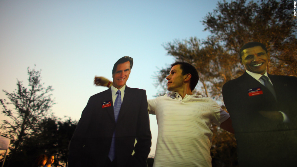 Bartek Wawruch stands between cardboard cutouts of Obama and Romney at Lynn University in Boca Raton, Florida, on Saturday, October 20, as the campus prepares for Monday's presidential debate.