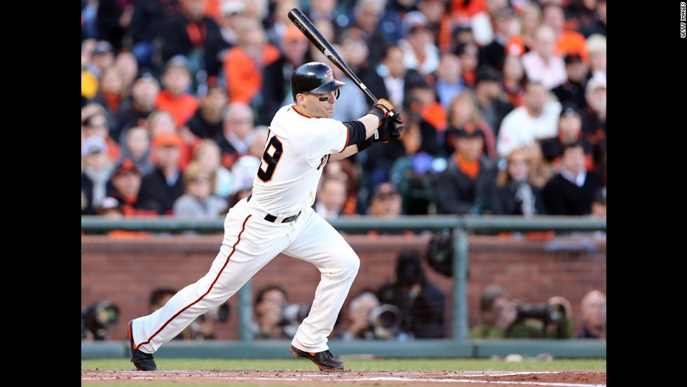 No. 19 Marco Scutaro of the Giants singles in the first inning.