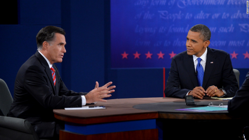Obama listens as Romney responds to a question Monday.