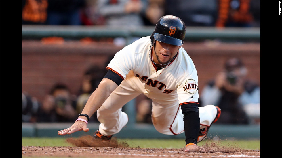 No. 7 Gregor Blanco of the San Francisco Giants scores on a base hit by No.18 Matt Cain in the second inning.