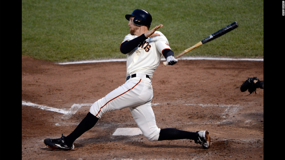 No. 8 Hunter Pence of the San Francisco Giants hits a three-run double in the third inning against the St. Louis Cardinals.