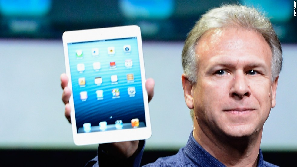 Apple marketing chief Phil Schiller holds up an iPad Mini, revealed during an announcement on Tuesday.