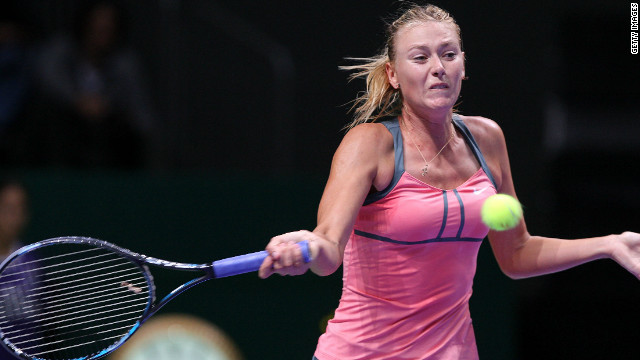 Maria Sharapova returns a shot against Sara Errani as the Russian won her opening White Group clash at the WTA Championships in Istanbul.