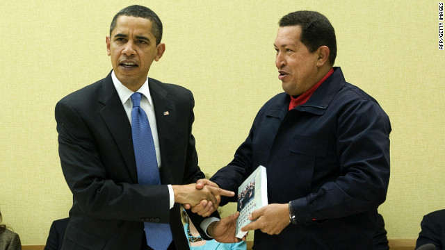 Venezuelan President Hugo Chavez (R) gives a book, 'The Open Veins of Latin America' of Uruguayan writer Eduardo Galeano to US President Barack Obama (L) during a multilateral meeting to begin during the Summit of the Americas at the Hyatt Regency in Port of Spain, Trinidad April 18, 2009.