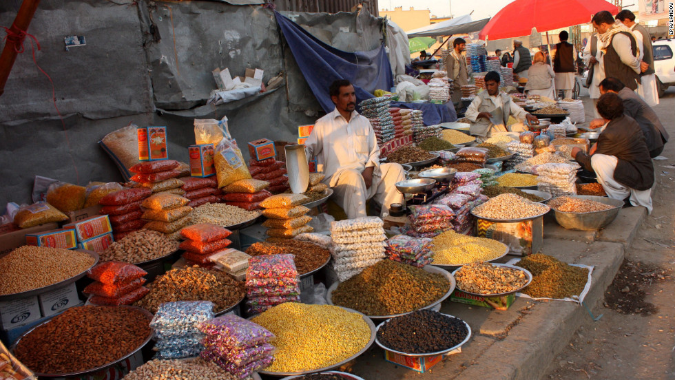 An Afghan man sells dried fruits on a roadside in Kabul, Afghanistan, on Wednesday, October 24.