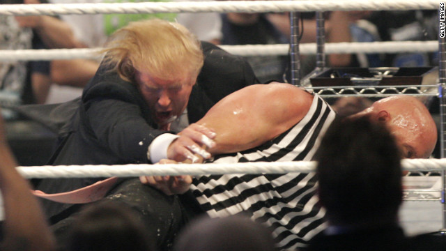 DETROIT - APRIL 1: Donald Trump gets taken to the mat by 'Stone Cold' Steve Austin after the the Battle of the Billionaires at the 2007 World Wrestling Entertainment's Wrestlemania April 1, 2007 at Ford Field in Detroit, Michigan. (Photo by Bill Pugliano/Getty Images)