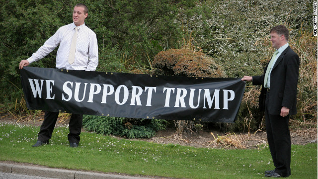 Supporters of US tycoon Donald Trump are pictured outside the Aberdeen Exhibition & Conference centre where Donald Trump attends a  public inquiry over his plans to build a golf resort near Aberdeen,  on June 10, 2008. Trump wants to build a giant complex on the Scottish east coast near Aberdeen, but has run into opposition from environmentalists and a local farmer who refuses to budge. The Scottish government has called for a full public inquiry into the plans. AFP PHOTO/Ed Jones (Photo credit should read ED Jones/AFP/Getty Images)