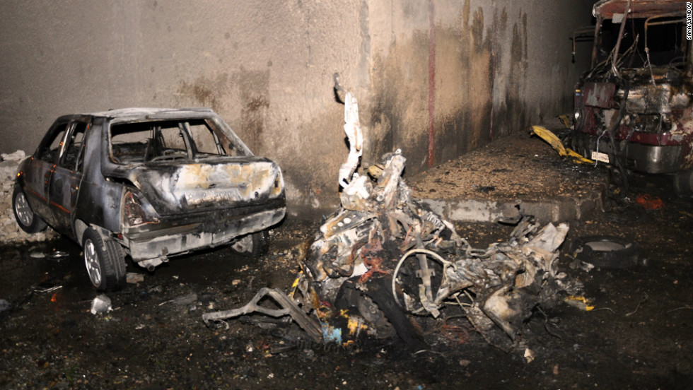 Cars destroyed by the car bomb explosion in Damascus on Wednesday.