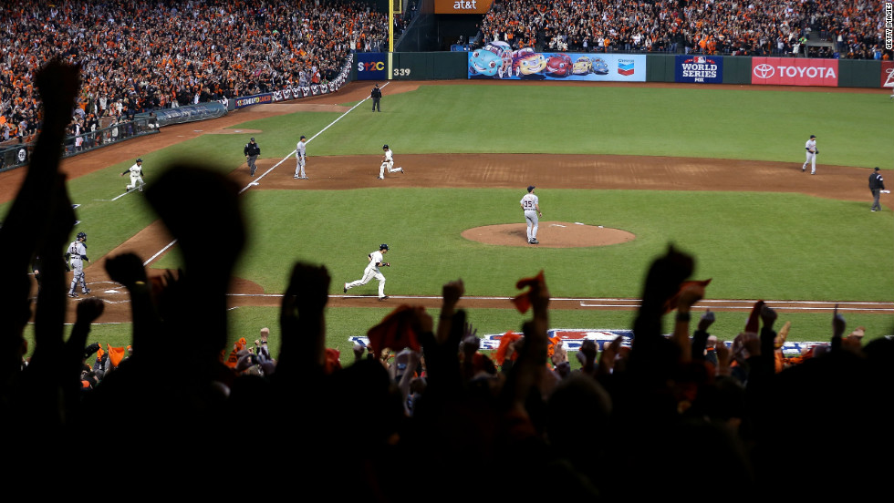Angel Pagan of the San Francisco Giants advances after Marco Scutaro hit a single against Justin Verlander of the Detroit Tigers.