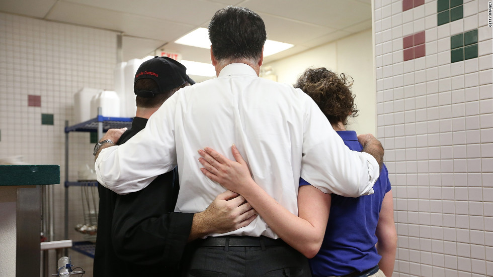Romney, center, poses for a photo with workers at First Watch Cafe on Thursday.