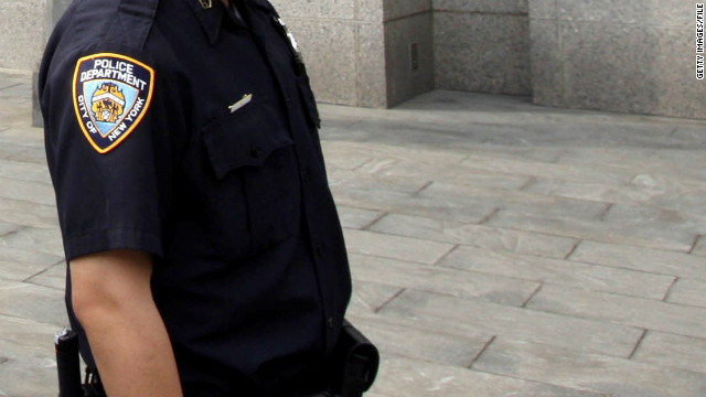 A New York police officer stands outside the Manhattan federal court on May 6, 2010.