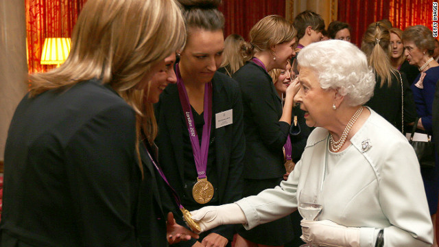 The Queen meets British Olympians at a reception hours before two athletes had their medals stolen from a nightclub.