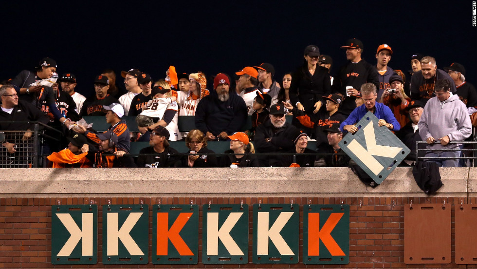 "Giants fans hang ""K"" signs on the outfield wall for the number of strike-outs recorded by pitcher Madison Bumgarner."
