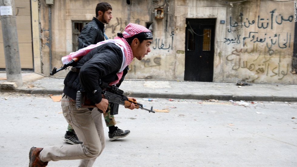 Syrian rebels run to take position in the Bustan al-Basha district in Aleppo on Friday.