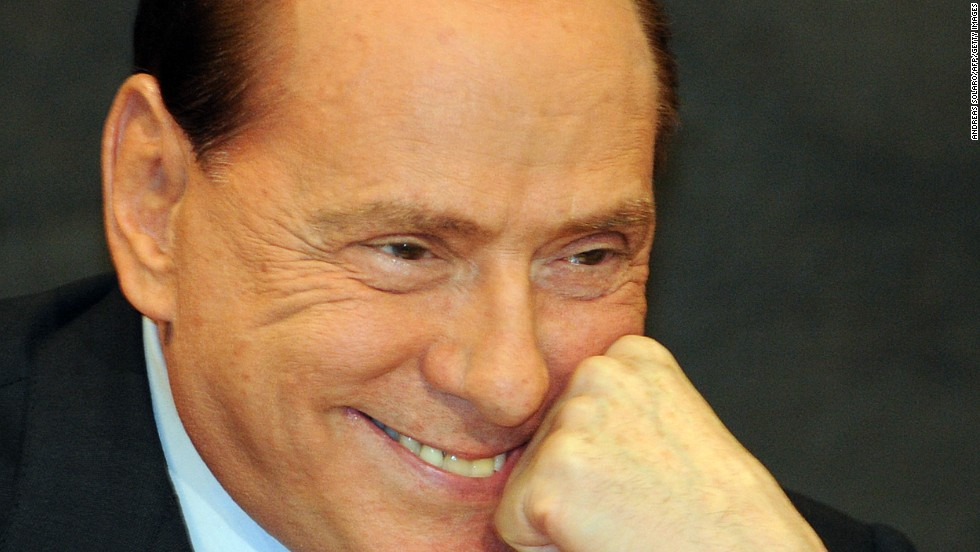 "Berlusconi reacts during the presentation of politician Antonio Razzi's book ""Le mie mani pulite"" (My clean hands) at the Italian parliament in Rome on February 1, 2012."