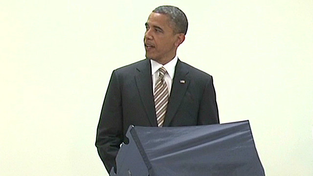 Obama jokes around while voting