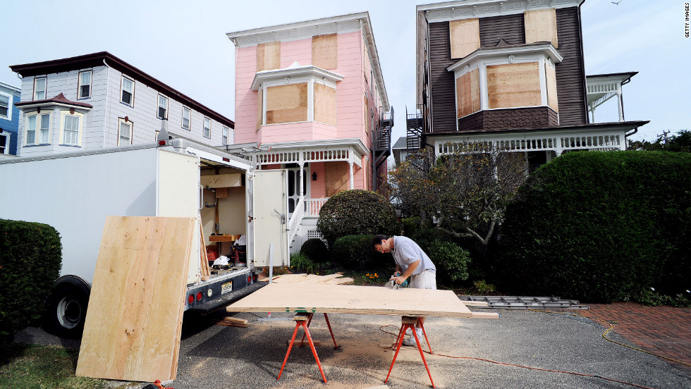 Burt Myrich boards up a home in preparation for Hurricane Sandy on Saturday in Cape May, New Jersey.