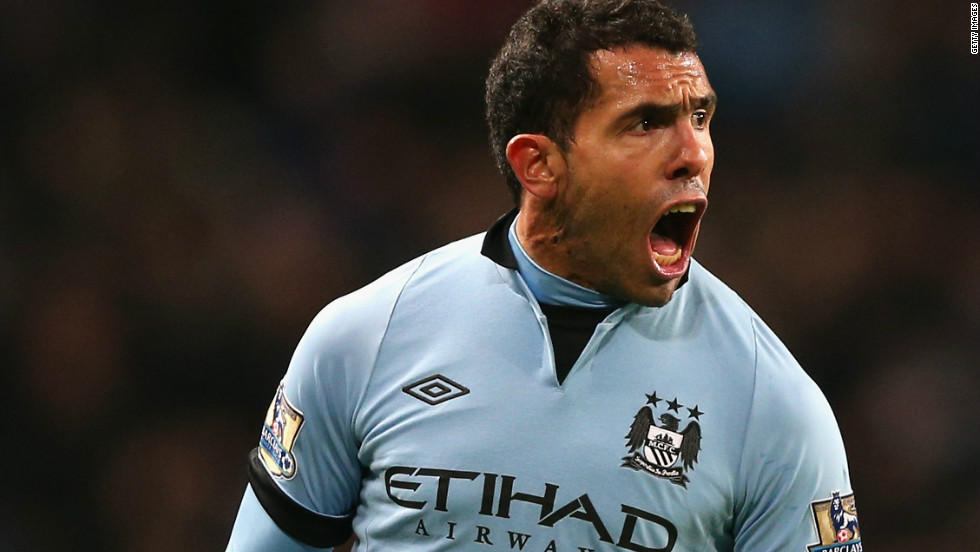 Carlos Tevez celebrates after scoring the only goal in Manchester City's 1-0 win at home to Swansea.