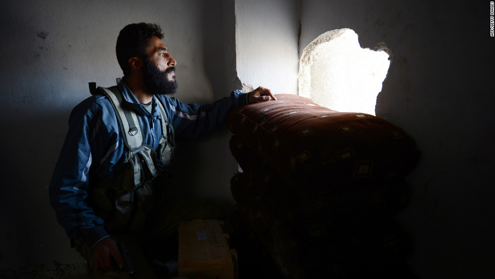 Commander Abu Sleiman looks at the pro-Syrian government forces' position prior to an attack in Aleppo on Saturday, October 27.  The latest reports of violence saw each side accuse the other of violating the conditions of a cease-fire called over religious holiday Eid al-Adha.