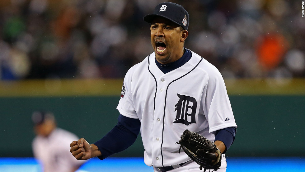 Octavio Dotel of the Tigers reacts after striking out Buster Posey of the Giants in the eighth inning.