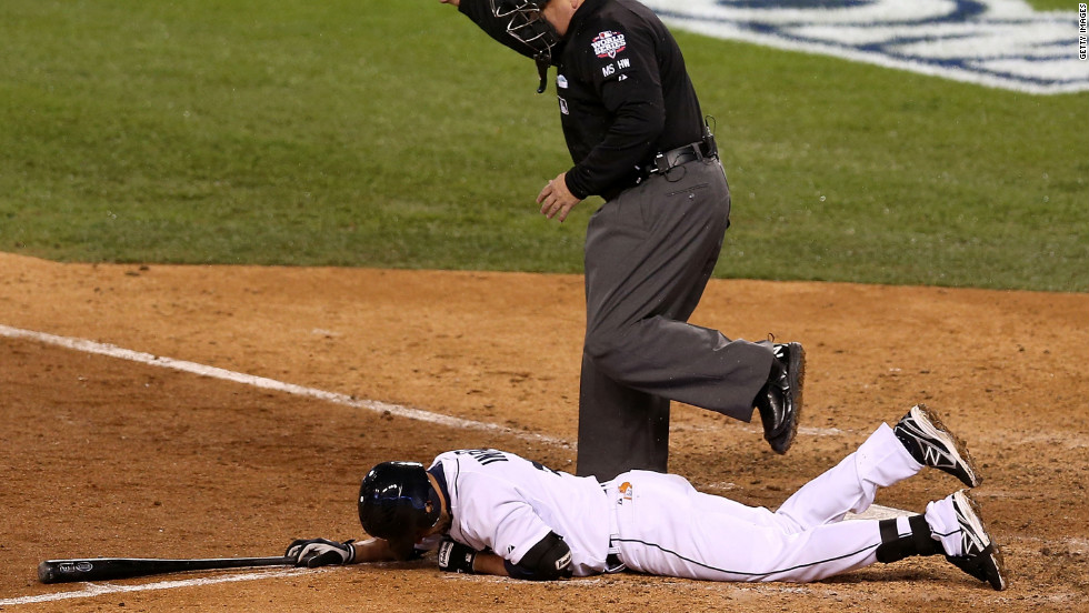 Omar Infante of the Tigers falls to the ground after being hit by a pitch thrown by Santiago Casilla of the Giants in the ninth inning.