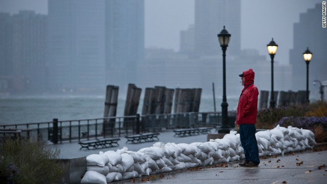 A man watches the waves in New York Harbor from Battery Park during the arrival of Hurricane Sandy on October 29, 2012 in New York City. The core of Sandy's force is supposed to hit the New York area Monday night.