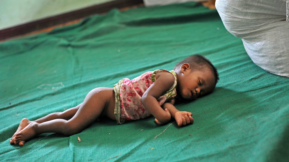 A baby sleeps at a refugee camp in Mrauk U in Myanmar on Sunday. The U.N. is already assisting 75,000 people forced to flee earlier this year when violence first erupted in western Myanmar.